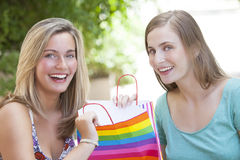 Happy friends with shopping bags Royalty Free Stock Photos
