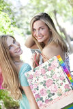 Happy friends with shopping bags Stock Photo