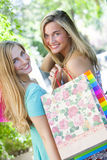 Happy friends with shopping bags Stock Images