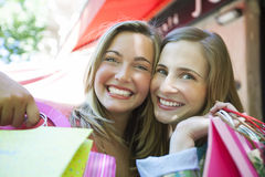 Happy friends with shopping bags Royalty Free Stock Photography