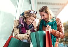 Happy friends shopping. Two beautiful young women enjoying shopping in the city Stock Photography