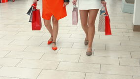 Happy friends shopping in mall. In high quality format stock footage
