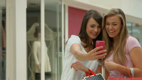 Happy friends in the shopping mall taking selfie. In high quality format stock footage