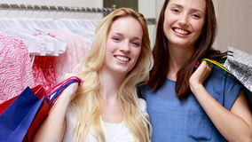Happy friends shopping together stock footage