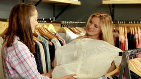 Happy friends shopping together in the mall. In high quality 4k format stock footage