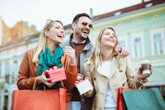 Happy friends shopping. Young friends enjoying shopping in the city Royalty Free Stock Photography
