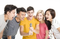 Happy friends singing song together Stock Photography