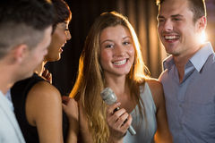 Happy friends singing song together. In bar Royalty Free Stock Photo