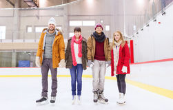 Happy friends on skating rink Stock Image