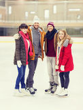 Happy friends on skating rink Royalty Free Stock Photos