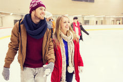 Happy friends on skating rink Royalty Free Stock Photography