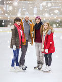 Happy friends on skating rink Royalty Free Stock Photo