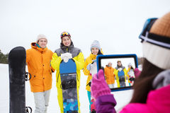 Happy friends with snowboards and tablet pc Stock Photo
