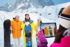 Happy friends with snowboards and tablet pc Royalty Free Stock Photos