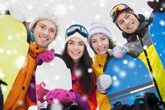 Happy friends with snowboards Stock Image