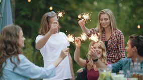 Happy friends with sparklers having fun outdoors stock video