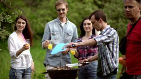 Making barbecue. BBQ party of close friends stock video footage