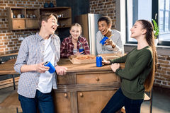 Happy friends spending time together with pizza and soda drinks Stock Photography