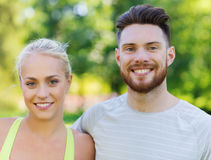 Happy friends or sportsmen couple hugging outdoors Royalty Free Stock Photo