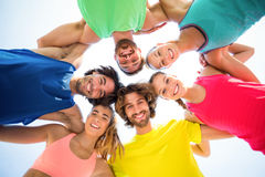 Happy friends standing with arm around Stock Photos