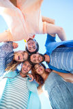 Happy friends standing in circle and looking at camera Stock Image