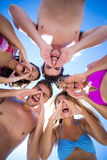 Happy friends standing in circle and shouting Royalty Free Stock Photos