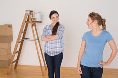 Happy friends standing in a new house Royalty Free Stock Photo