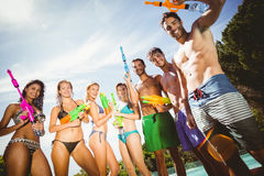 Happy friends standing with water guns Royalty Free Stock Photo