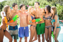Happy friends standing with water guns Stock Images