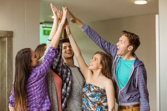 Happy friends students high five for their teamwork Stock Photography