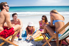 Happy friends sunbathing together Royalty Free Stock Photo