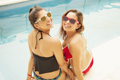 Happy friends in swimming pool Stock Photos