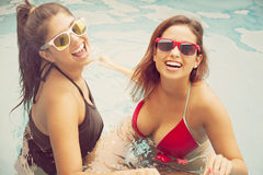 Happy friends in swimming pool Royalty Free Stock Photo
