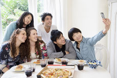 Happy friends taking photograph Stock Photography