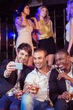 Happy friends taking selfie Royalty Free Stock Image