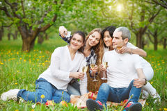 Happy friends taking selfie with camera or smartphone Stock Image