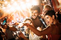 Happy friends taking selfie at music festival Stock Image