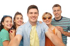 Happy friends taking selfie over white background stock photos