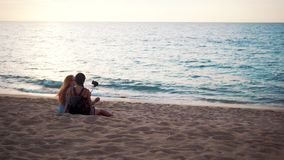 Happy friends taking selfie photo on the beach stock footage