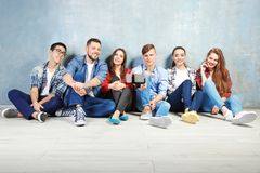 Happy friends taking selfie while sitting on floor Royalty Free Stock Photography