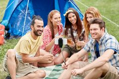 Happy friends taking selfie by smartphone at camp Stock Photography
