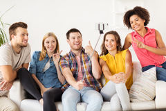 Happy friends taking selfie by smartphone at home Royalty Free Stock Images