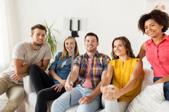Happy friends taking selfie by smartphone at home Royalty Free Stock Photos