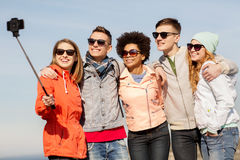 Happy friends taking selfie by smartphone outdoors Royalty Free Stock Photography