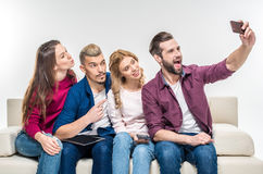 Happy friends taking selfie Stock Image