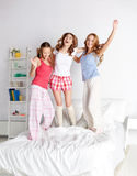 Happy friends or teen girls having fun at home Royalty Free Stock Photo