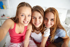Happy friends or teen girls taking selfie at home Royalty Free Stock Image