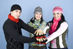 Happy friends with their hands together in unity Royalty Free Stock Photography
