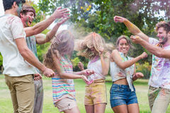 Happy friends throwing powder paint Royalty Free Stock Images