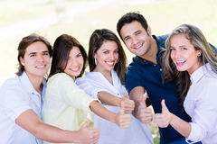 Happy friends with thumbs up Stock Photo